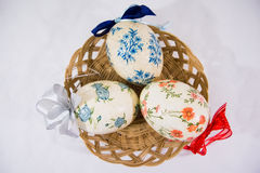 Group of colorful easter eggs decorated with flowers made by decoupage technique, in a basket Stock Photo