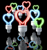 Group of colorful fluorescent lamps, heart shaped, red, blue, green glow, 3d rendering on dark background Stock Photos