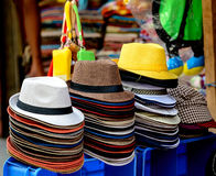 Group of colorful hats at a market stall Stock Photo