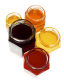 Group of colorful hexagonal jars. Isolated on white filled with jam Royalty Free Stock Photos