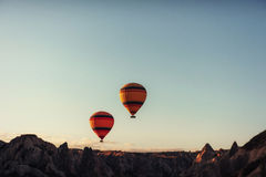 Group of colorful hot air balloons against a blue sky. A group of colorful hot air balloons against a blue sky Royalty Free Stock Photography