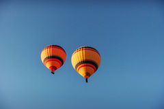 Group of colorful hot air balloons against a blue sky. A group of colorful hot air balloons against a blue sky Stock Image
