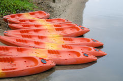 Group of colorful kayak. Colorful fiberglass kayaks tethered to each other Stock Photo