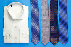 Group of colorful neckties and shirt Stock Images