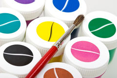Group of colorful paint cans with brush Royalty Free Stock Image