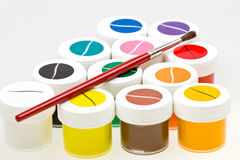 Group of colorful paint cans with brush Stock Photos