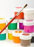 Group of colorful paint cans with brush Stock Photography