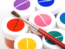 Group of colorful paint cans with brush Stock Photo