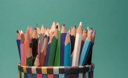 Group of colorful pencils in a ocean blue background stock photography
