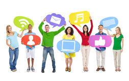 Group of Colorful People Holding Speech Bubbles Royalty Free Stock Photo