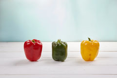 Group of colorful peppers on the wooden background. Top view Royalty Free Stock Photos