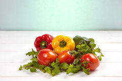 Group of colorful peppers on the wooden background. Top view Royalty Free Stock Photo