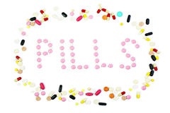 Group of colorful pills with pills word isolated. On white Royalty Free Stock Images