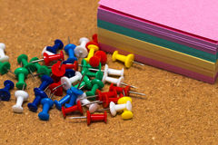 Group of colorful push pins on cork board Royalty Free Stock Photos