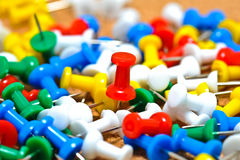 Group of colorful push pins on cork bulletin board Royalty Free Stock Photos