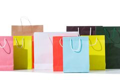 Group of colorful shopping bags. Isolated on white stock image