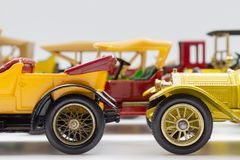 A group of colorful veteran scale model cars. Some Matchbox Models of Yesteryear models. Side view royalty free stock photos