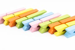 Group of colorful wooden clothespins Stock Images
