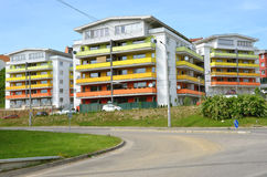 Group of coloured apartment dwelling houses next to the public route Stock Photography