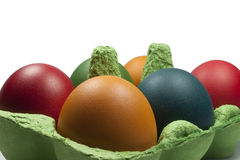 Group of Coloured Easter eggs in the Egg Carrier. Closeup on the Group of Coloured Easter eggs in the Green Egg Carrier Royalty Free Stock Images