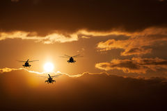 Group combat helicopters, Mi-24, Mi-8. On a background of clouds royalty free stock images