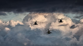 Group combat helicopters, Mi-24, Mi-8. On a background of clouds stock photography