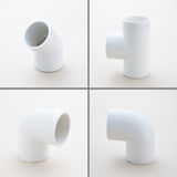 Group of combined fittings for PVC pipes Royalty Free Stock Image