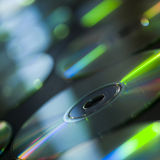 Group of compact discs on table Royalty Free Stock Image