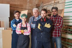 Group of competent and successful carpenters. At workshop Stock Photos