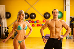 Group of competitors train posing before bodybuilding competitio Royalty Free Stock Image
