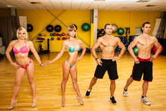 Group of competitors train posing before bodybuilding competitio Royalty Free Stock Photography
