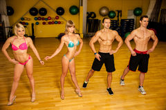 Group of competitors train posing before bodybuilding competition stock photos