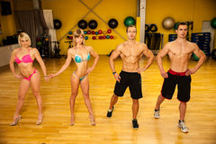 Group of competitors train posing before bodybuilding competition Royalty Free Stock Image