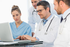 Group of concentrated doctors using laptop Stock Photos
