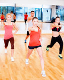 Group of concentrated people exercising in the gym Stock Photos