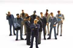 Group concept. Group of miniature business men in suits Royalty Free Stock Image