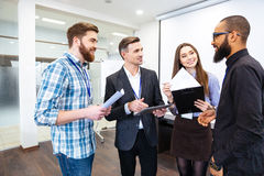 Group of confident business people on meeting with team leader Royalty Free Stock Photos