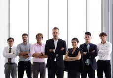 Group of business people with arms crossed in office stock images