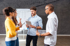 Group of confident people discussing new project in conference room Royalty Free Stock Images