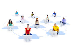 Group of Connected Multi-Ethnic People Sitting on a Cloud. With computer Stock Images