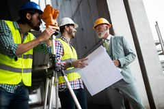 Group of construction engineer working in construction site royalty free stock images