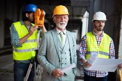 Group of construction engineer working in construction site stock photo