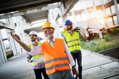 Group of construction engineer working in construction site royalty free stock image