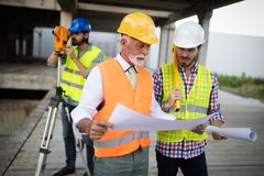 Group of construction engineer working in construction site royalty free stock photo