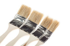 Group of construction paintbrushes Stock Photos