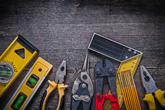 Group of construction tooling on wooden background Royalty Free Stock Photos