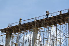 Group of construction worker fabricating beam formwork Royalty Free Stock Photography