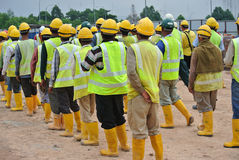 Group of construction workers assemble at the open space. Stock Photography