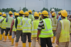 Group of construction workers assemble at the open space. Royalty Free Stock Photography