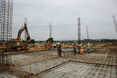 A group of construction workers casting floor slab Royalty Free Stock Images